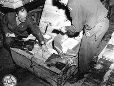 The boxes of hidden documents were opened back at the G-2 warehouse in Frankfurt, Germany. (111-SC-229100), photo: US National Archives