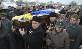 Ukrainian priests and protesters carry a coffin with the body of one of two protesters who died of gunshot wounds in Nakonecne, Ukraine, Jan. 27, 2014, photo: CTK
