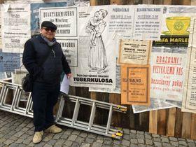 Vojtěch Merunka in front of posters in Interslavic, photo: archive of Vojtěch Merunka