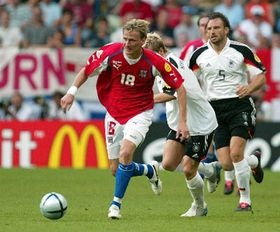 Marek Heinz, in red, dribbles past German players, photo: CTK