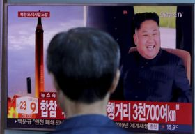 A man watches a TV screen showing a file footage of North Korea's missile launch and North Korean leader Kim Jong Un, at the Seoul Railway Station, South Korea, September 15, 2017, photo: CTK