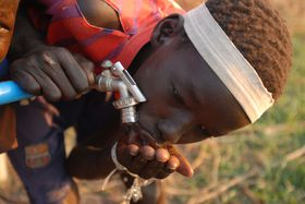 A boy from South Sudan drinks water from a tab in Tergol town, Ethiopia, photo: © UNICEF Ethiopia/2014/Bizuwerk, CC BY-NC-ND 2.0