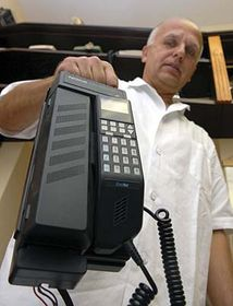 Lubomír Nečas with one of the first mobile phones ever used, photo: CTK