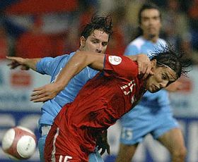 Czech striker Milan Baros, right, and Nicola Albani of San Marino fight for the ball, photo: CTK