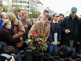 Prague Mayor Jan Kasl placing flowers on a memorial commemorating victims of the American tragedy