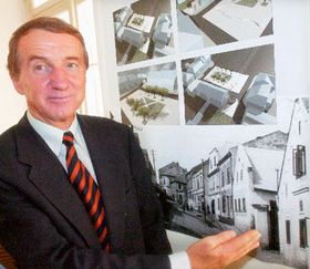 The mayor of Horni Benesov Josef Klech shows the photo of the house of Kerry's grandfather, photo: CTK