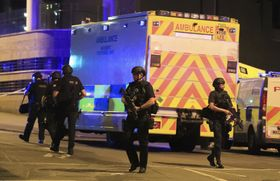 Armed police work at Manchester Arena after reports of an explosion at the venue, photo: CTK