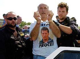 Protester under arrest, photo: CTK