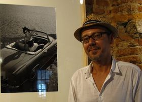Martin Fojtek next to a photograph by Vilém Heckel, photo: Masha Volynsky