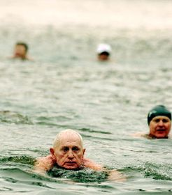 91 year old Ladislav Nicek swims in the cold river, photo: CTK