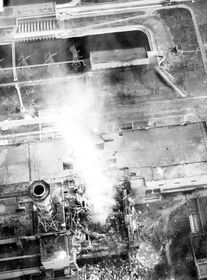Aerial view into the core, smoke from the graphite fire and core melt down. The photo was taken from a helicopter on May 3, 1986, of the destroyed Unit 4, foto: Soviet Authorities / Official website of the Chernobyl Nuclear Power Plant