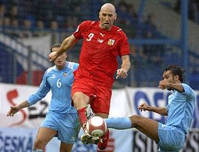 Simone Bacciocchi, left, and Alessandro della Valle, right, of San Marino try to stop Czech striker Jan Koller, photo: CTK