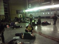 Helpers attend to injured people inside the Manchester Arena, photo: CTK