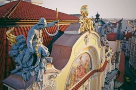 Statute of a firefighter rescuing a woman on the roof of the old Prague Insurance Company building, photo: Amos Chapple