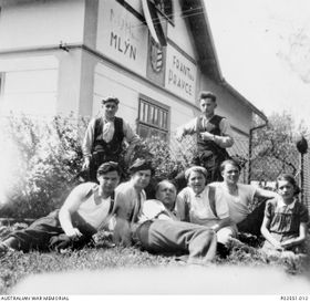 """Lawrence Saywell, """"Mac"""" Kerkham and some of the local villagers in Miřetín, photo: Australian War Memorial, Public Domain"""