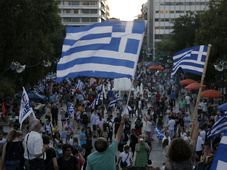 Supporters of the No vote wave Greek flags after the referendum's exit polls at Syntagma square in Athens, July 5, 2015, photo: CTK