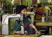 Korean seamstress in Skutec factory, photo: CTK