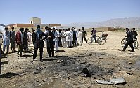 Afghans gather at the site of a suicide attack in Parwan province, Afghanistan, July 8, 2014, photo: CTK