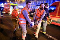 A woman is being evacuated from the Bataclan theater after a shooting in Paris, November 13, 2015, photo: CTK