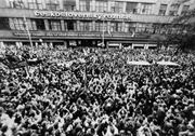 A gathering of Prague citizens and Czech Radio employees in front of the radio buil- ding in November 1989 to demand