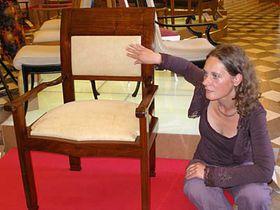 Adriana Primusova with the newly-recovered chair designed by Josip Plecnik, photo: Linda Mastalir