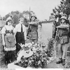Local villagers around the grave of Australian soldier Lawrence Saywell in the Evangelical Cemetery in the village of Miřetín, photo: Australian War Memorial, Public Domain