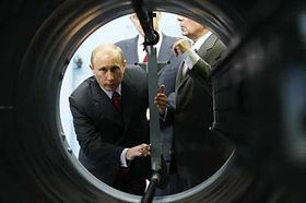 Russian Prime Minister Vladimir Putin looks at machinery while touring the Almaz-Antei consortium, producing air defense weapons, photo: CTK