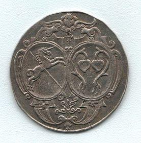 Medaile manželů zÚjezda kzaložení kostela vBřeznici roku 1638, zdroj: Wikipedia Commons / PD