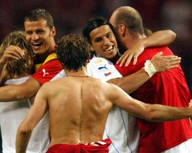 Milan Baros, second from left, hugs teammate Jan Koller as they celebrate their 3-0 win over Denmark, photo: CTK