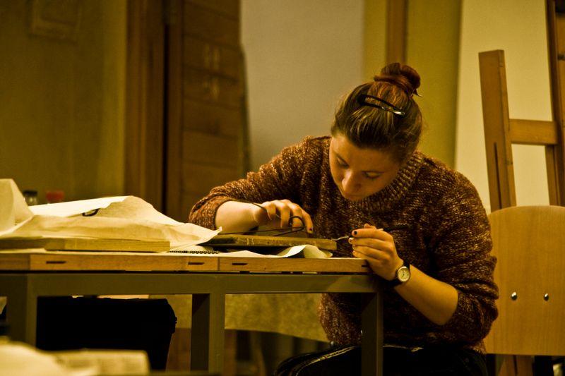 Working on a bookbinding, photo: Vít Pohanka