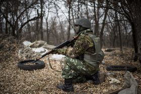 Ukrainian serviceman gets ready to fire near Trehizbenka village, Ukraine, November 23, 2014, photo: CTK