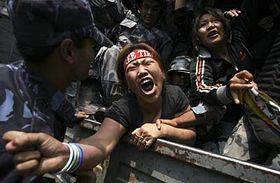 A Tibetan protester shouts slogans of 'Free Tibet' as she is detained while protesting against China outside the Visa section of Chinese Embassy in Katmandu, Nepal, photo: CTK